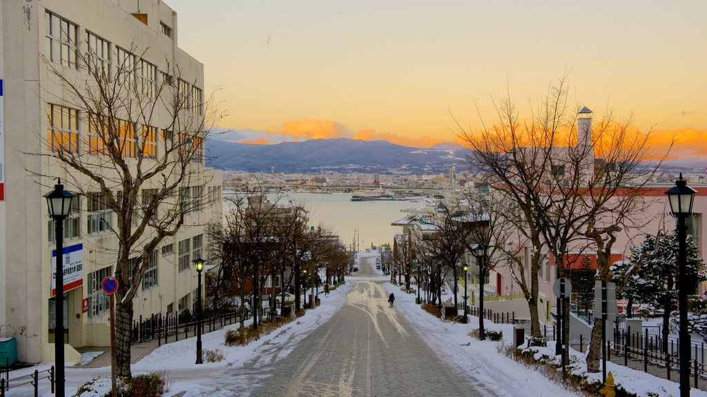 Hakodate which includes a sunset and street scenes