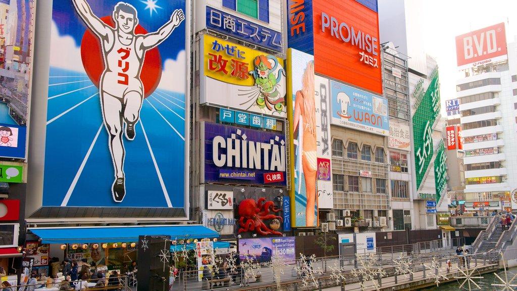 Dotonbori which includes city views and outdoor art