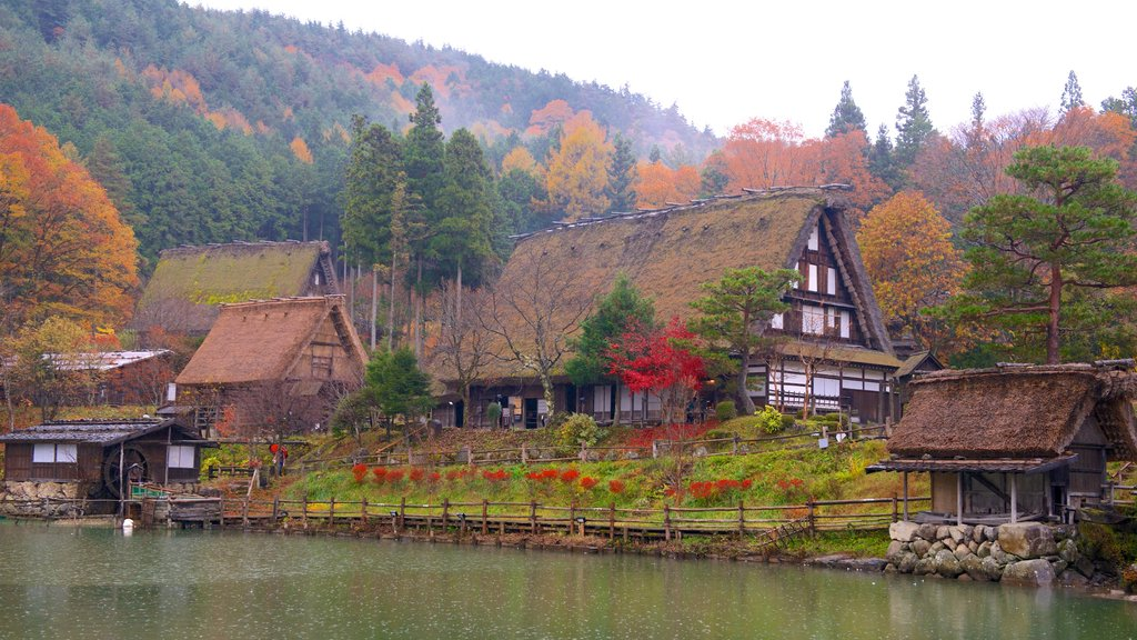 Hida Minzoku Mura Folk Village showing fall colors and a lake or waterhole