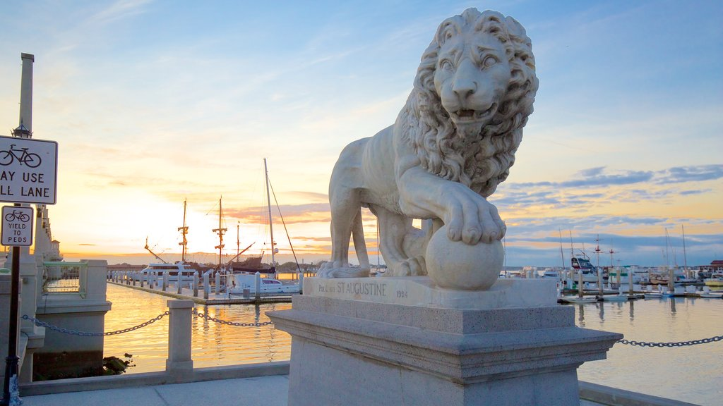 Bridge of Lions showing a statue or sculpture, general coastal views and a sunset