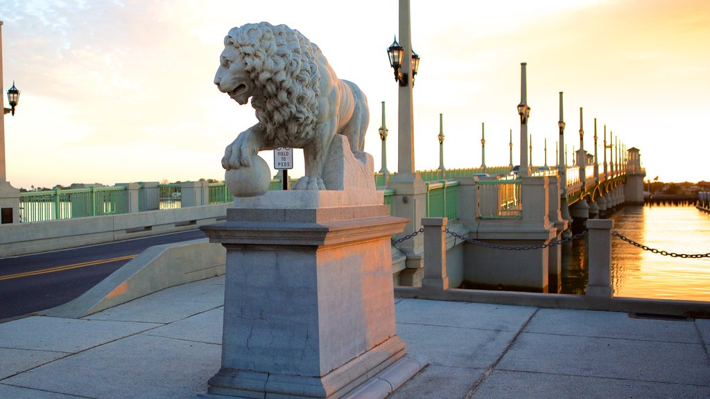 Bridge of Lions featuring a sunset and a statue or sculpture