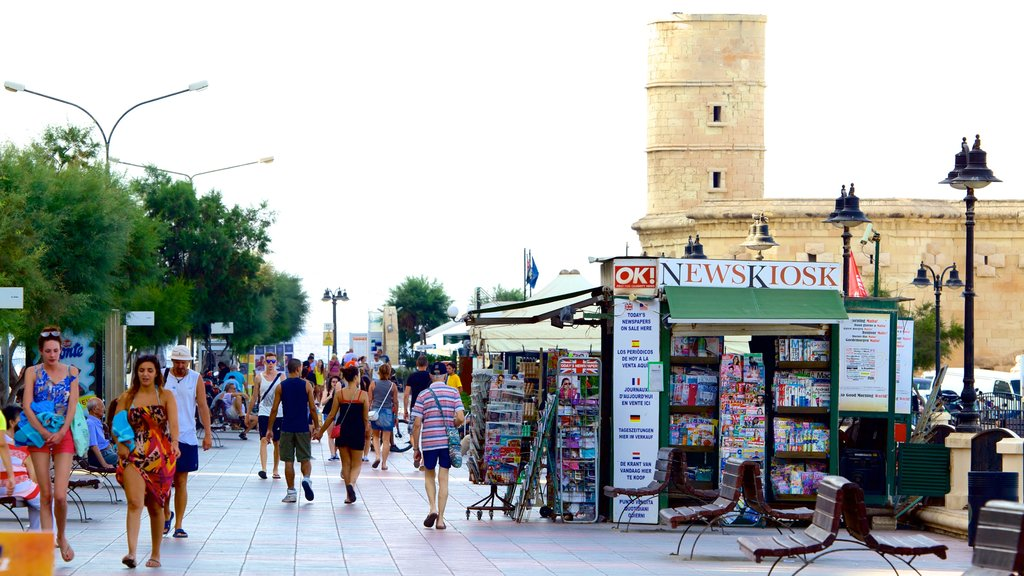 Sliema which includes hiking or walking as well as a large group of people