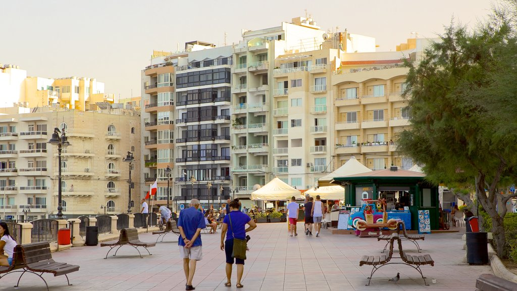 Sliema showing a city and hiking or walking as well as a couple