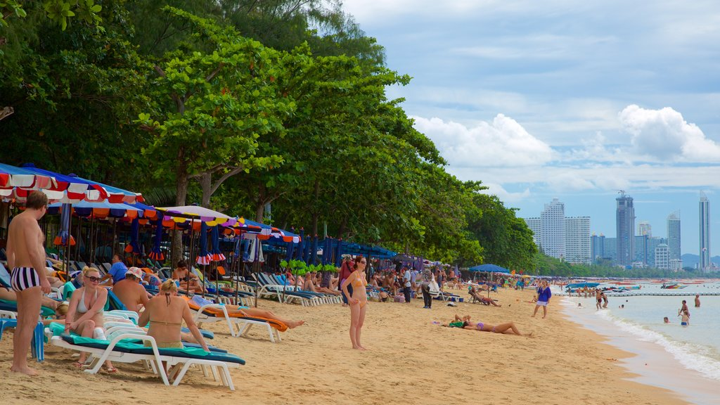 Dongtan Beach featuring a beach as well as a large group of people