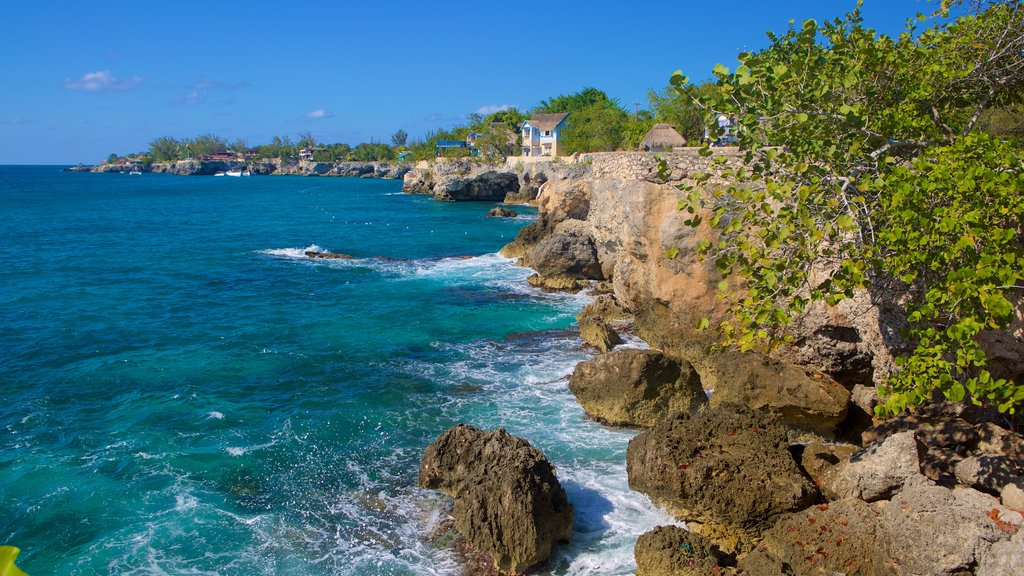 Negril Lighthouse featuring rugged coastline