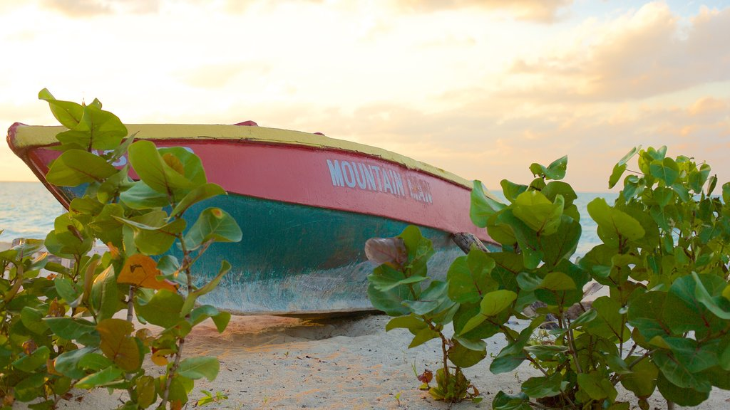 Negril featuring a sandy beach, a sunset and boating