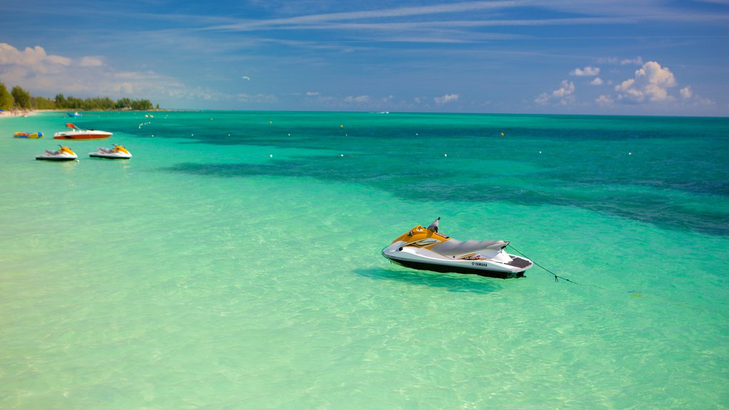 Taino Beach showing jet skiing and general coastal views