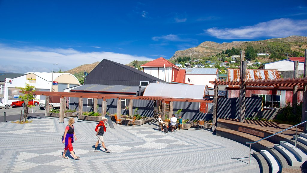 Lyttelton featuring a square or plaza as well as a small group of people