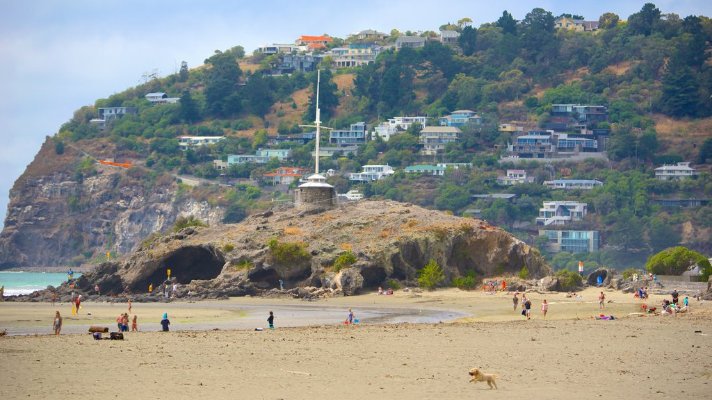 Cave Rock which includes a coastal town, caves and a beach
