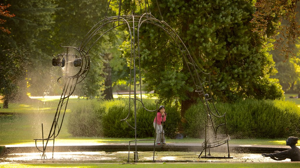Christchurch Botanic Gardens showing a fountain and a garden as well as an individual child