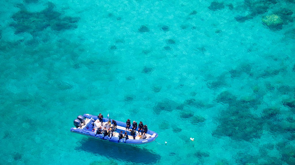 Noumea featuring boating and general coastal views as well as a small group of people