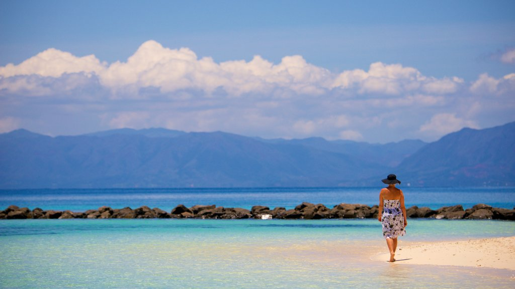 New Caledonia which includes mountains and a beach as well as an individual femail