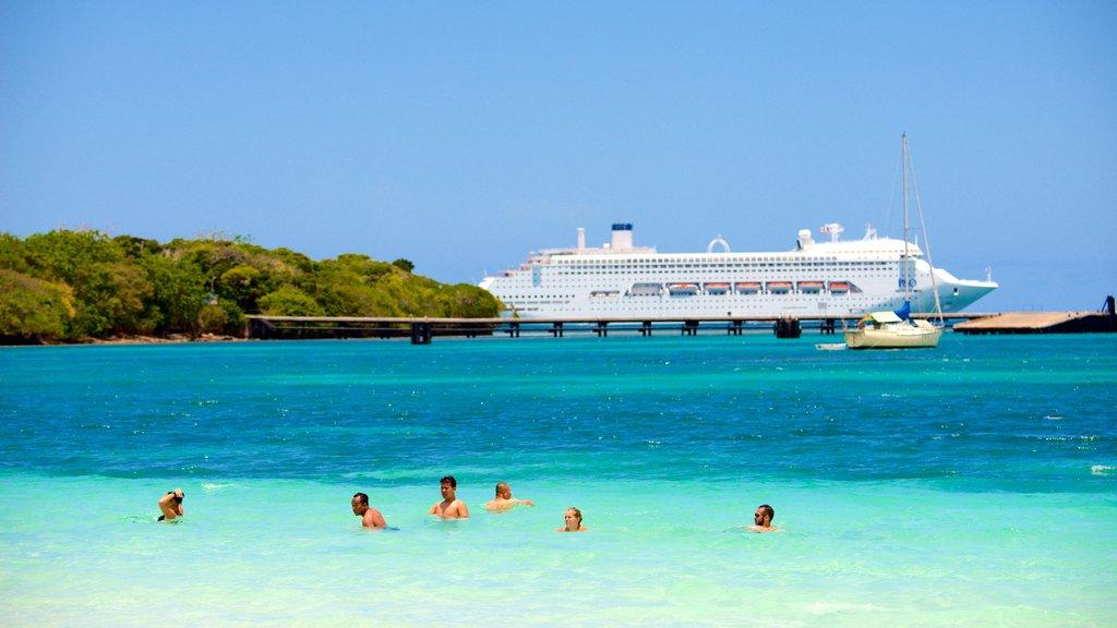 Kuto Beach featuring general coastal views, swimming and cruising