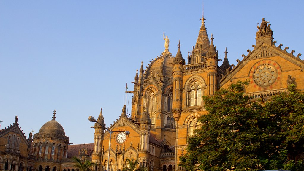 Mumbai which includes a sunset and heritage elements