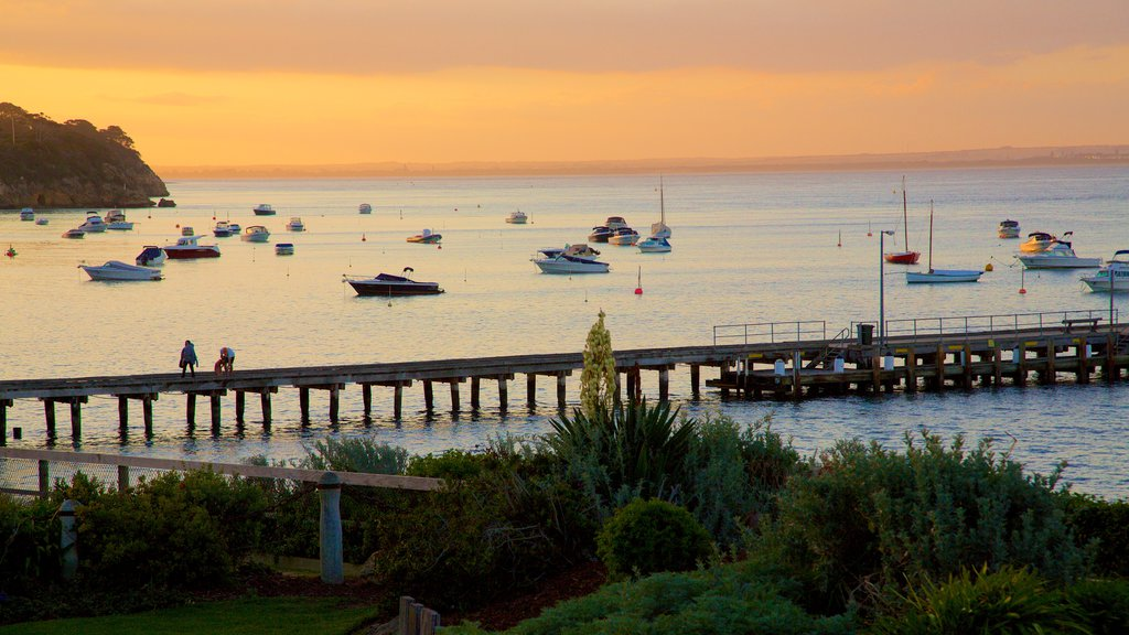 Portsea featuring general coastal views, sailing and a sunset