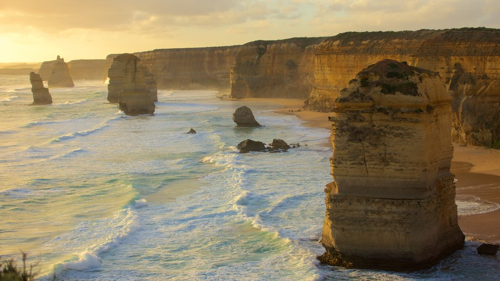 Twelve Apostles featuring a gorge or canyon, rocky coastline and a sunset
