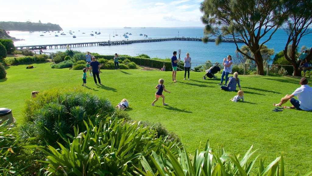 Portsea featuring a park as well as a large group of people