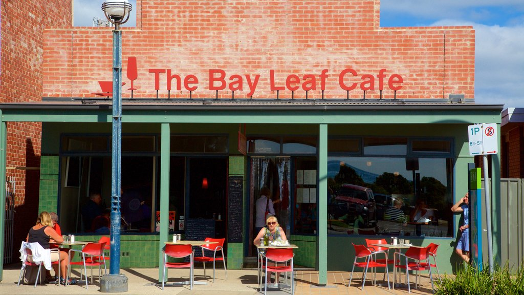 Apollo Bay featuring cafe lifestyle and outdoor eating as well as a small group of people