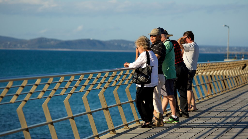 Lorne featuring general coastal views as well as a large group of people