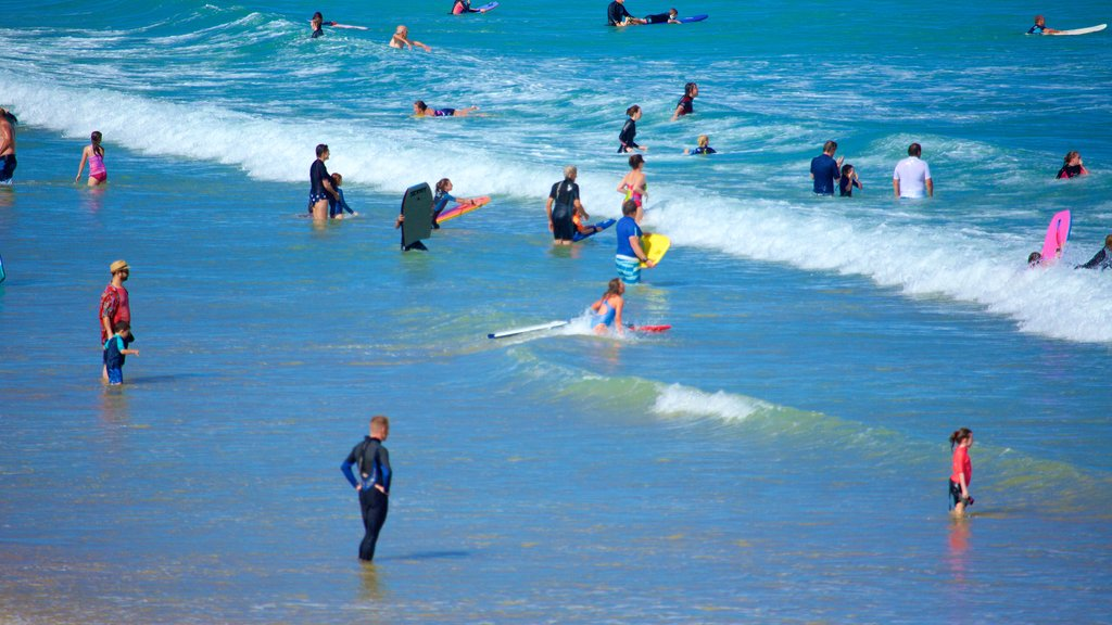 Anglesea showing swimming, surfing and surf