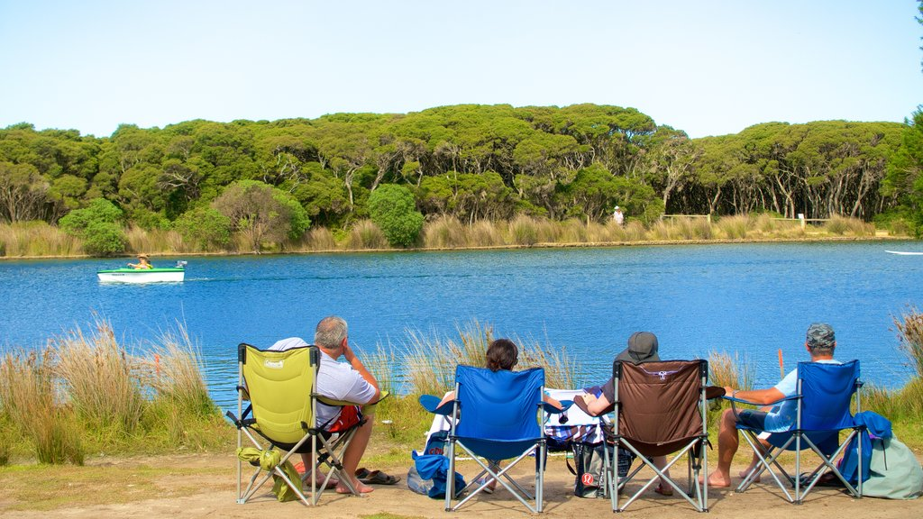 Anglesea which includes a river or creek as well as a small group of people