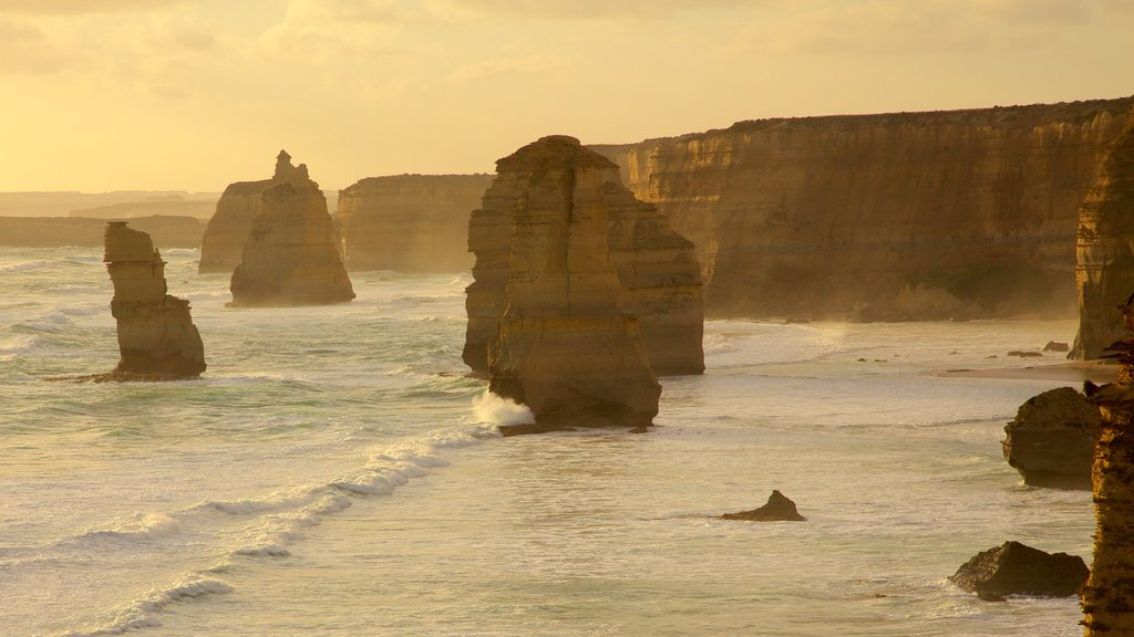 Twelve Apostles featuring a gorge or canyon, a sunset and rugged coastline