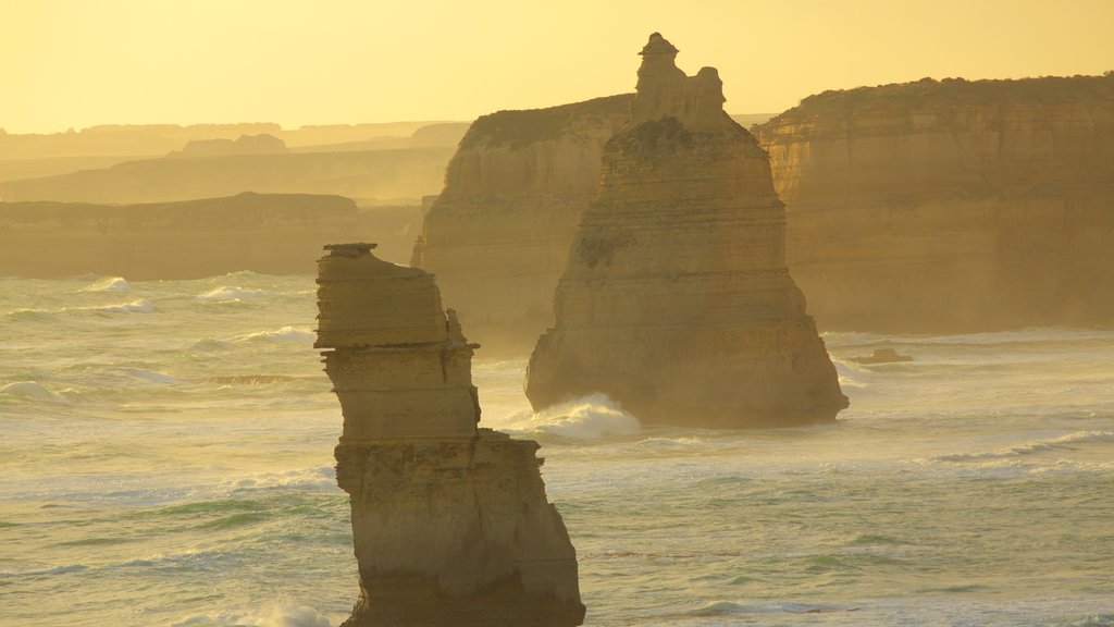 Twelve Apostles featuring general coastal views and a sunset