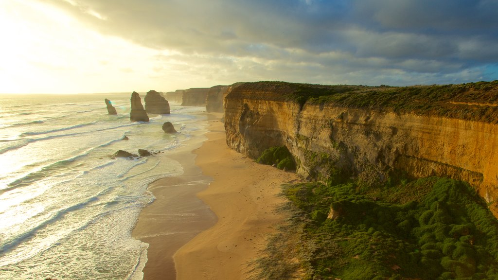 Twelve Apostles featuring rocky coastline, a sunset and a gorge or canyon