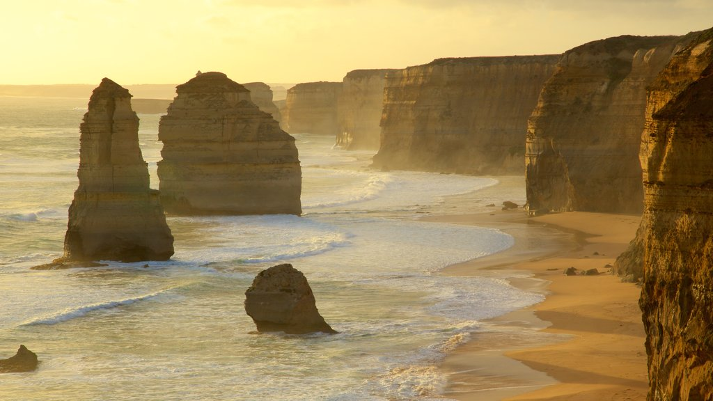 Twelve Apostles which includes rugged coastline, a sunset and a gorge or canyon
