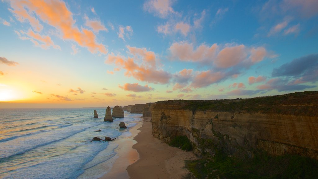 Twelve Apostles showing rugged coastline, a sunset and a gorge or canyon