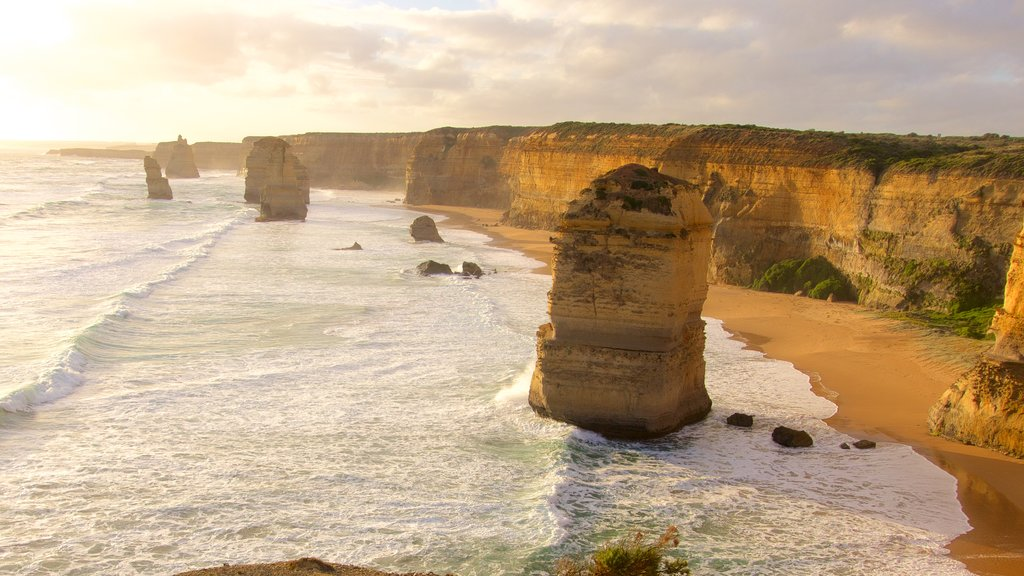 Twelve Apostles which includes a sunset, a gorge or canyon and rugged coastline