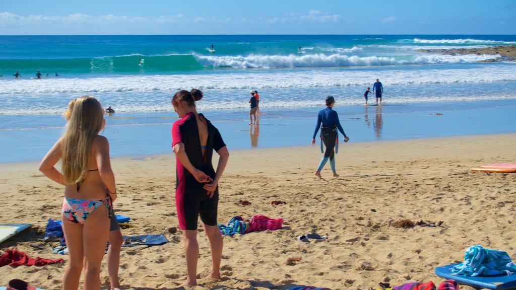 Great Ocean Road which includes a sandy beach as well as a large group of people