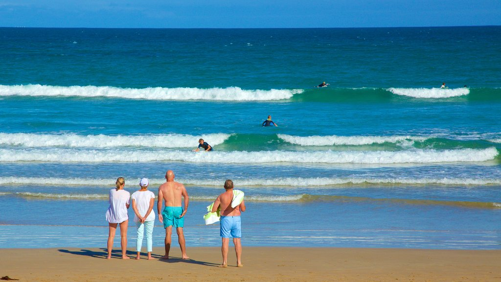 Great Ocean Road showing a sandy beach as well as a small group of people