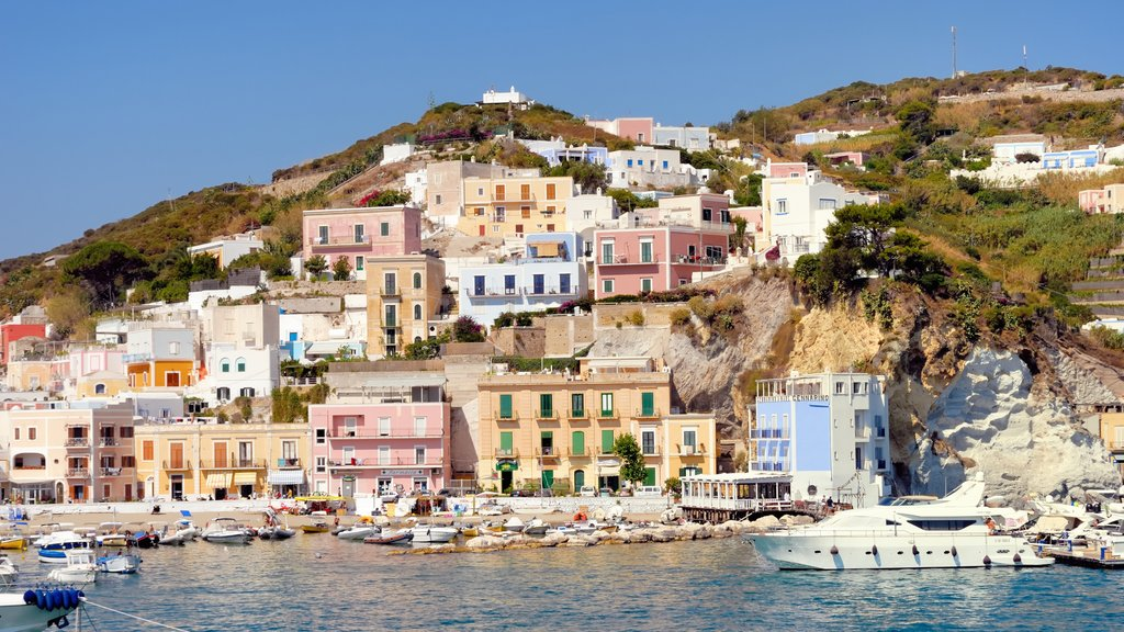 Ponza featuring a coastal town, rugged coastline and boating