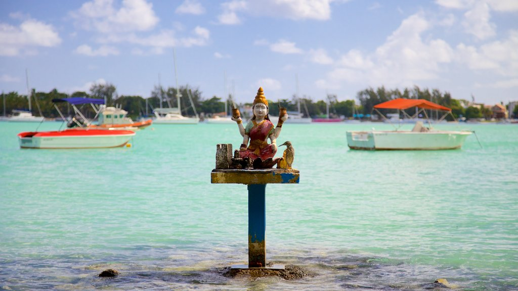 Grand Bay showing general coastal views and religious elements