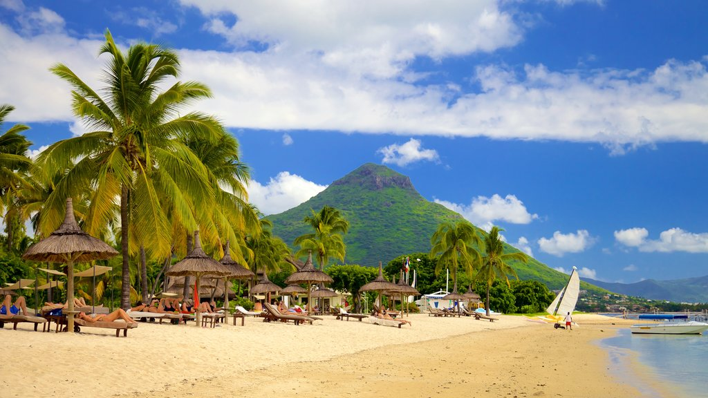 Flic-en-Flac which includes mountains, a luxury hotel or resort and a beach