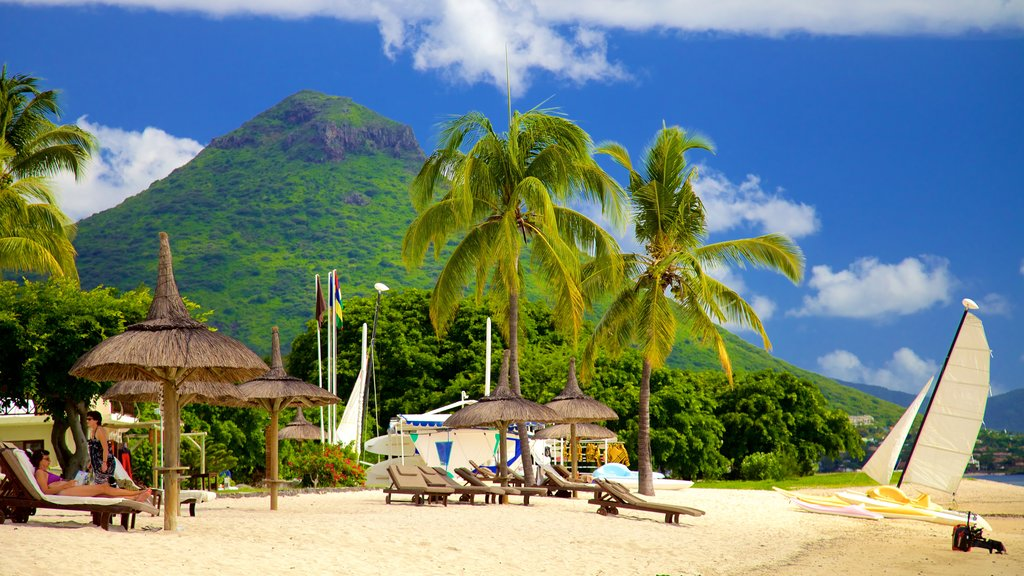 Flic-en-Flac featuring a beach, a luxury hotel or resort and mountains