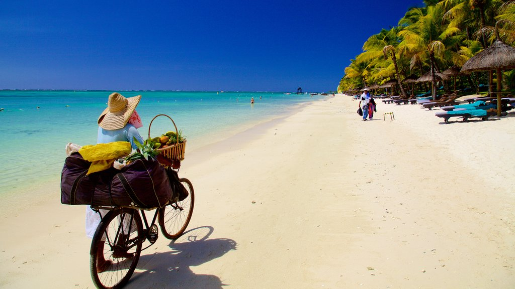 Trou aux Biches which includes cycling and a beach as well as an individual female