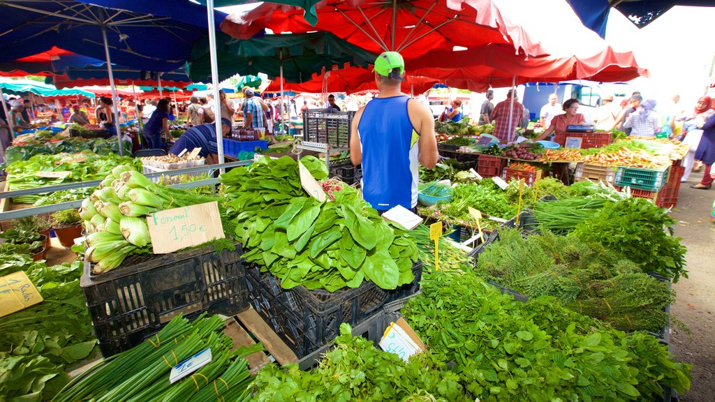 Saint-Paul which includes markets and food as well as an individual male