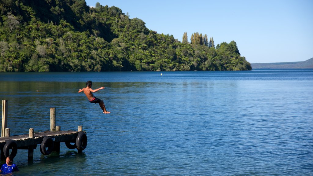 Lake Tarawera which includes a lake or waterhole as well as an individual male