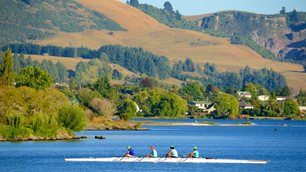 Lake Rotorua featuring mountains, a lake or waterhole and kayaking or canoeing