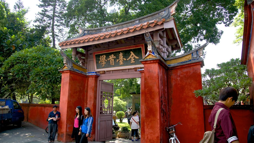 Confucius Temple showing a temple or place of worship as well as a small group of people