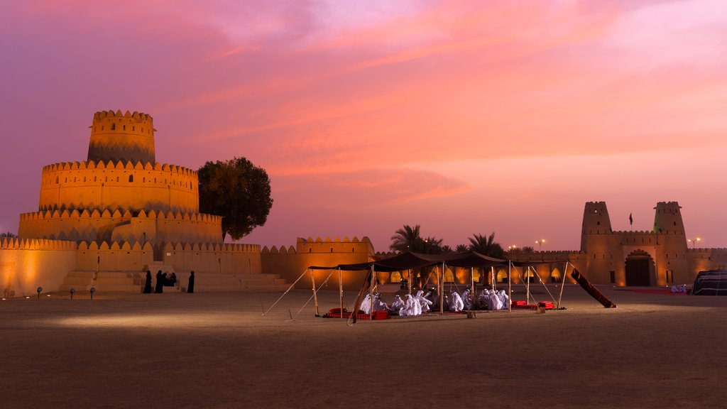 Yas Island which includes a sunset and desert views
