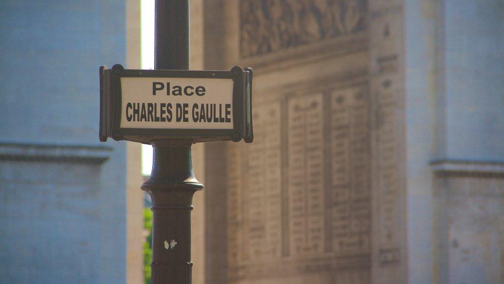 Arc de Triomphe featuring signage