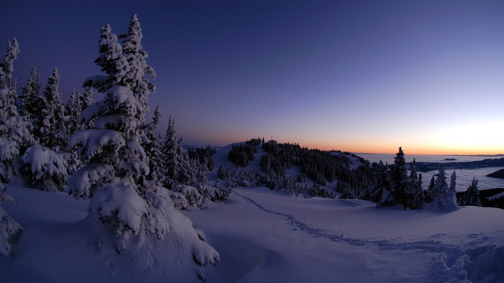Sun Peaks featuring a sunset and snow