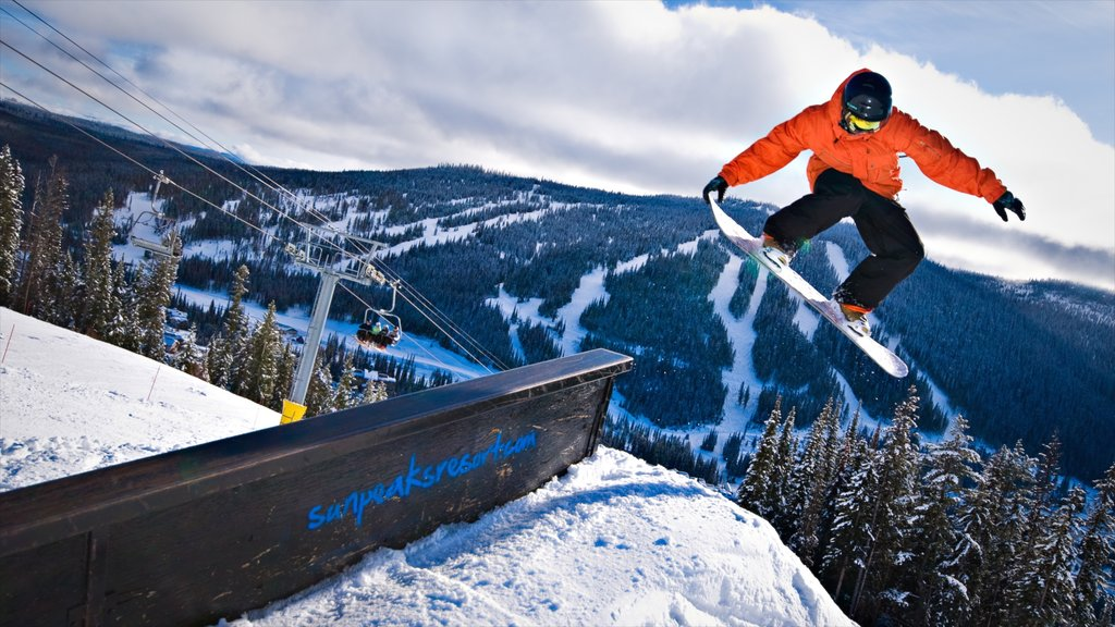 Sun Peaks featuring snow boarding and snow as well as an individual male