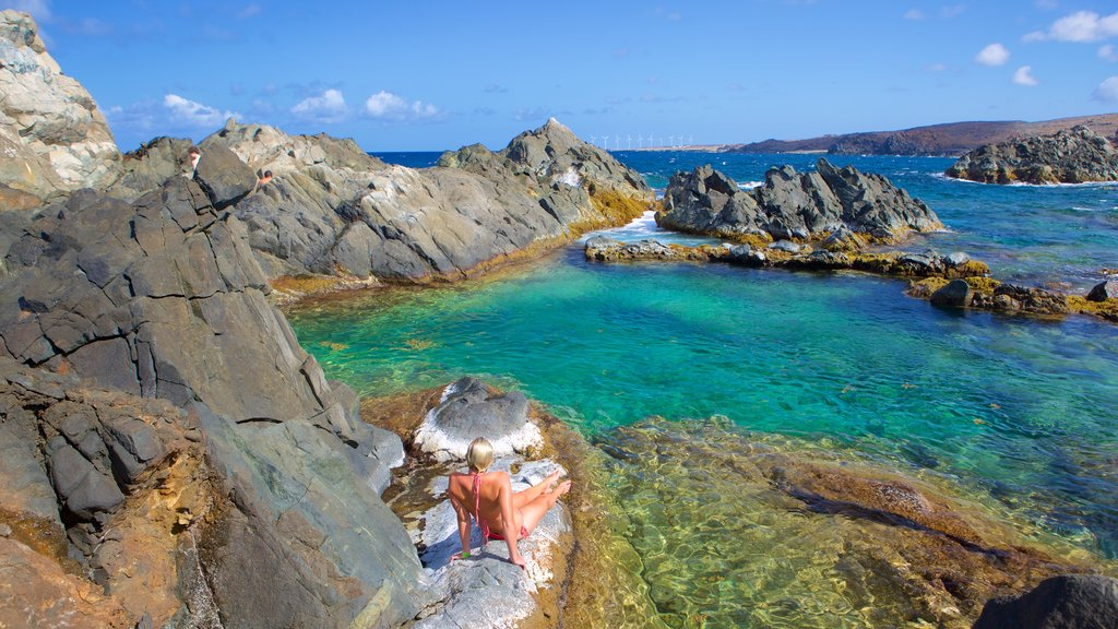 Conchi Natural Pool featuring general coastal views as well as an individual femail