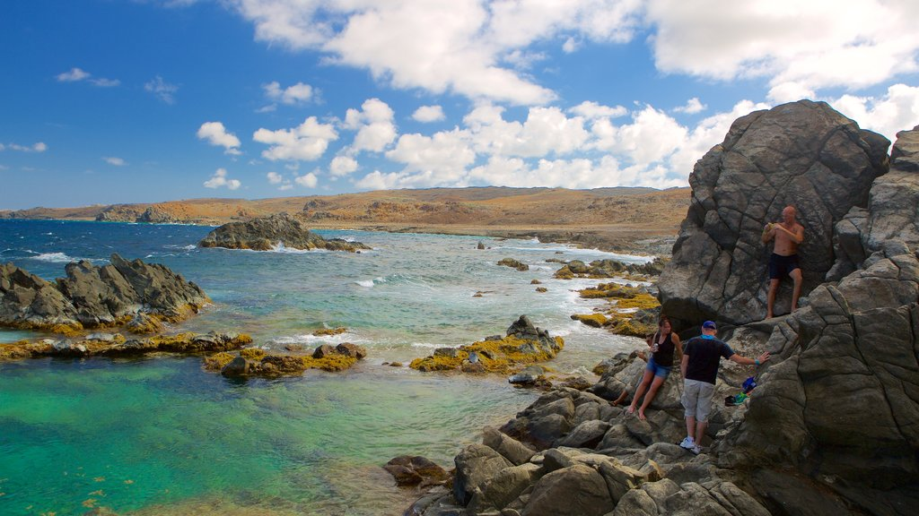 Conchi Natural Pool showing general coastal views as well as a small group of people