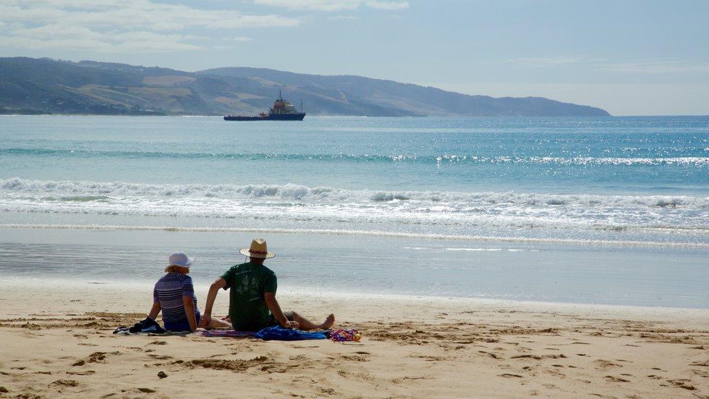 Apollo Bay showing a beach as well as a couple