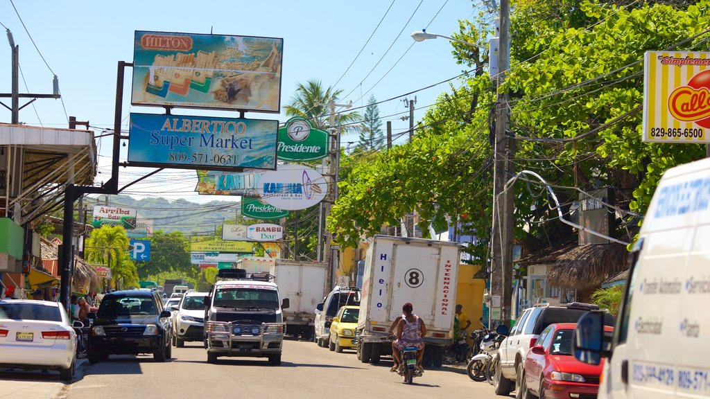 Puerto Plata featuring signage and street scenes